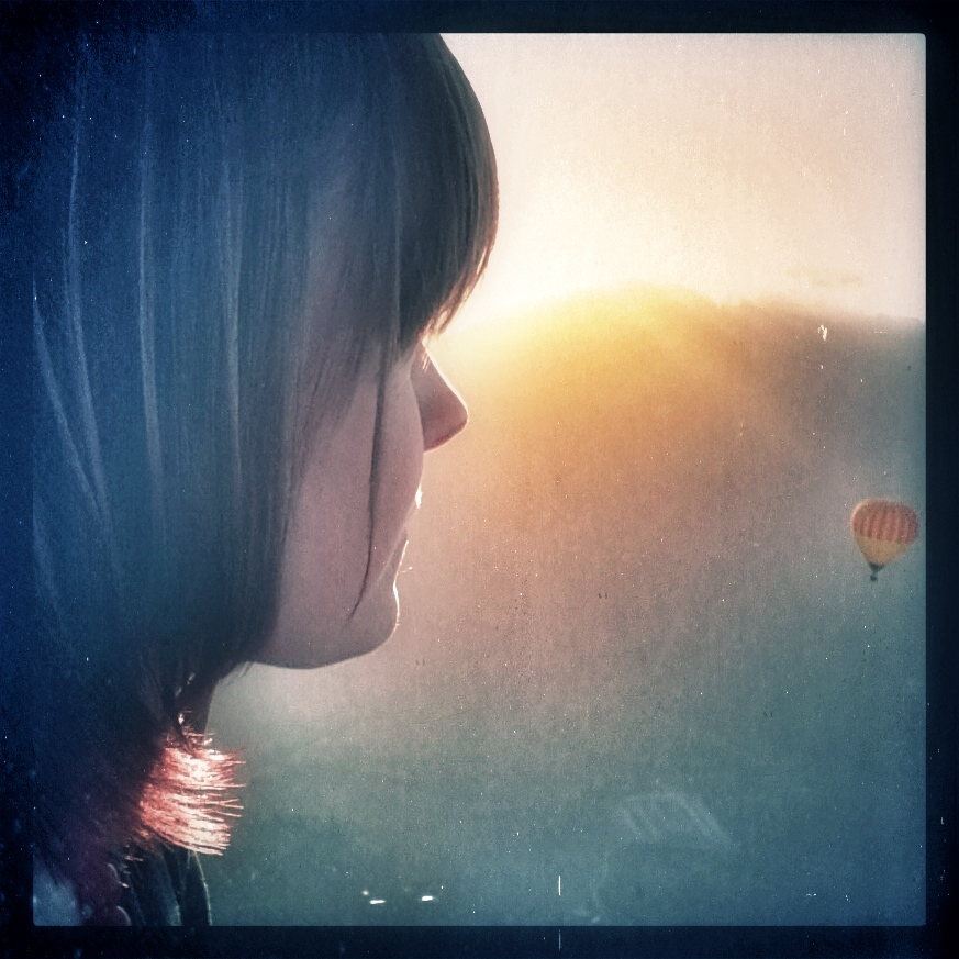 Emily Scheck @beijinemily gazes whistfully upon the beautiful sunrise and a hot air balloon over the Atherton Tabelands